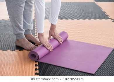 https://image.shutterstock.com/image-photo/man-rolling-yoga-mat-trainning-260nw-1027055869.jpg