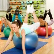 Women of Different Age (from 18 to 50) Doing Exercises with Balls